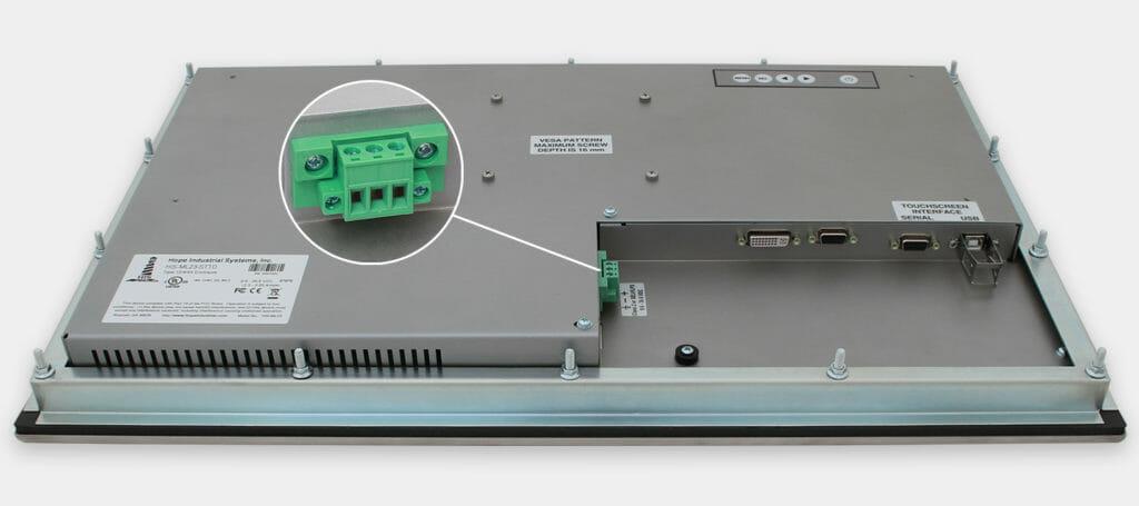"""Monitores industriales de montaje en panel con pantalla panorámica de 23"""" y pantallas táctiles resistentes según IP65/IP66, vista de salida para cables de CC"""