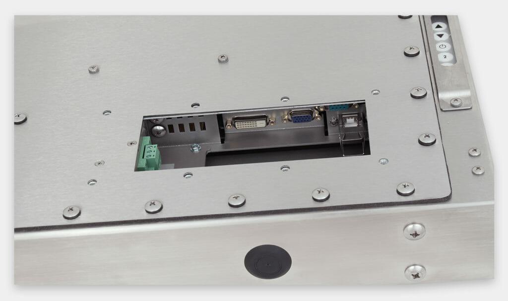 """Monitores industriales de montaje universal y pantallas táctiles resistentes según IP65/IP66 de 19"""", vista de salida para cables de CC"""